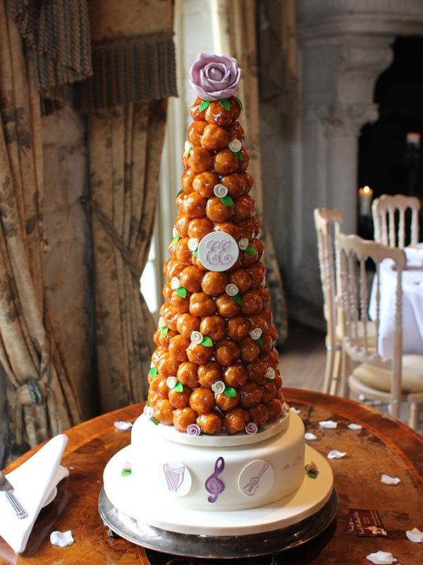 Traditional French Wedding Cakes Made Of Profiteroles Filled With Creme Patissiere And Lightly Coated Crispy Caramel